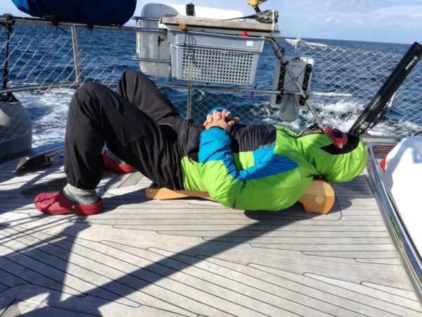 Patient using backrack on the yacht in Alaska