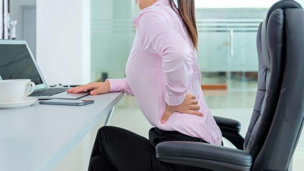 Lower back pain at work.
